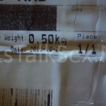 close up on weight and date of the box