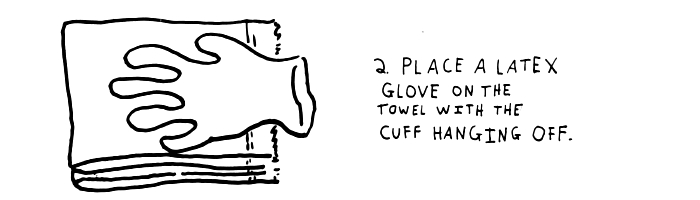 step-2-place-a glove-en-latex-on-the-towel-with-the-cuff-suspended