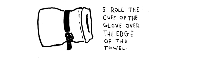 step-5-roll the cuff-on-the-glove-on-the-edge-of-the-towel