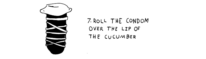 step-7-roll the condom on the cucumber lip