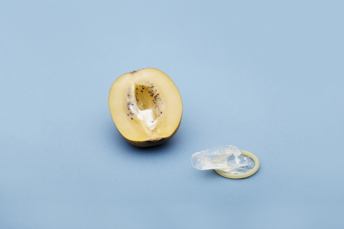 Filled peach with condom