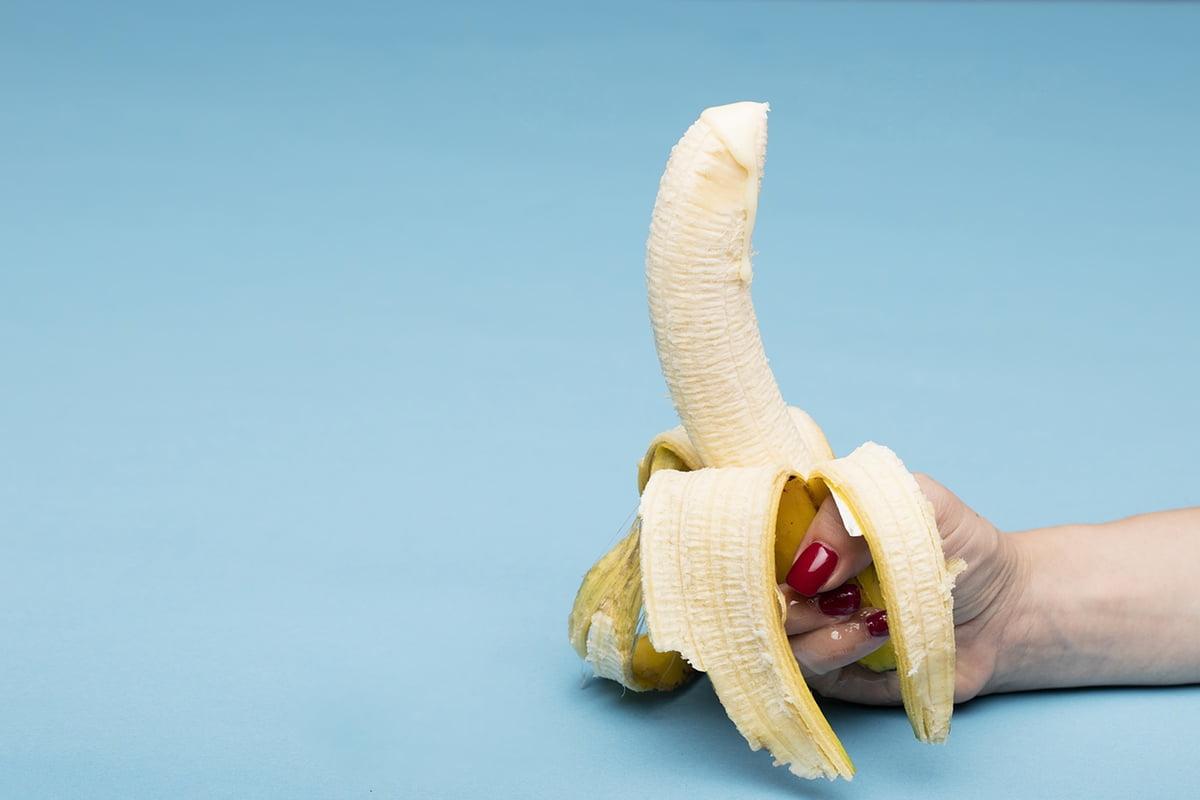 hand holding banana