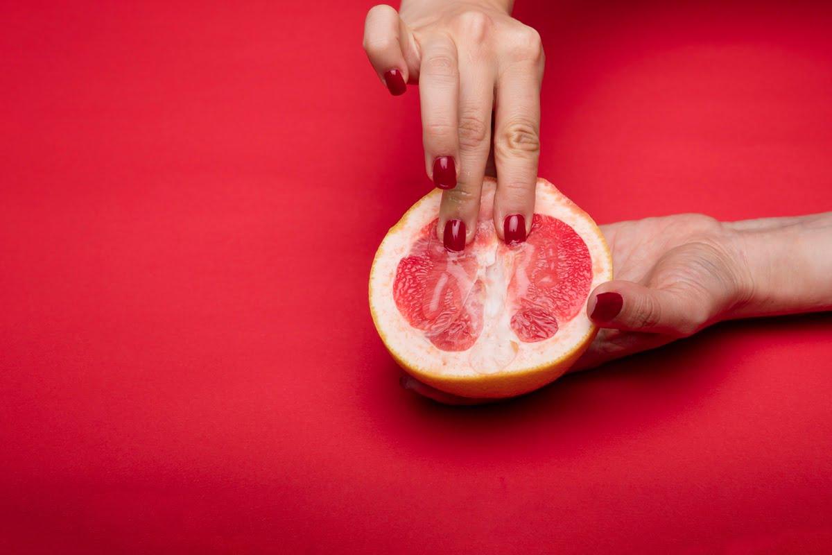 sex art hand touching pomegranade